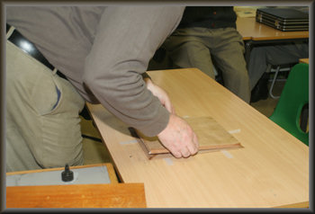 Placing glued baseboard on picture veneers